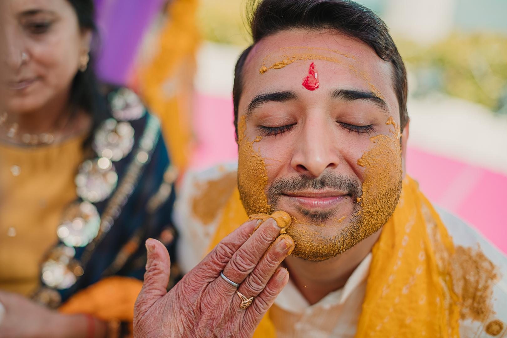 happy groom at his haldi