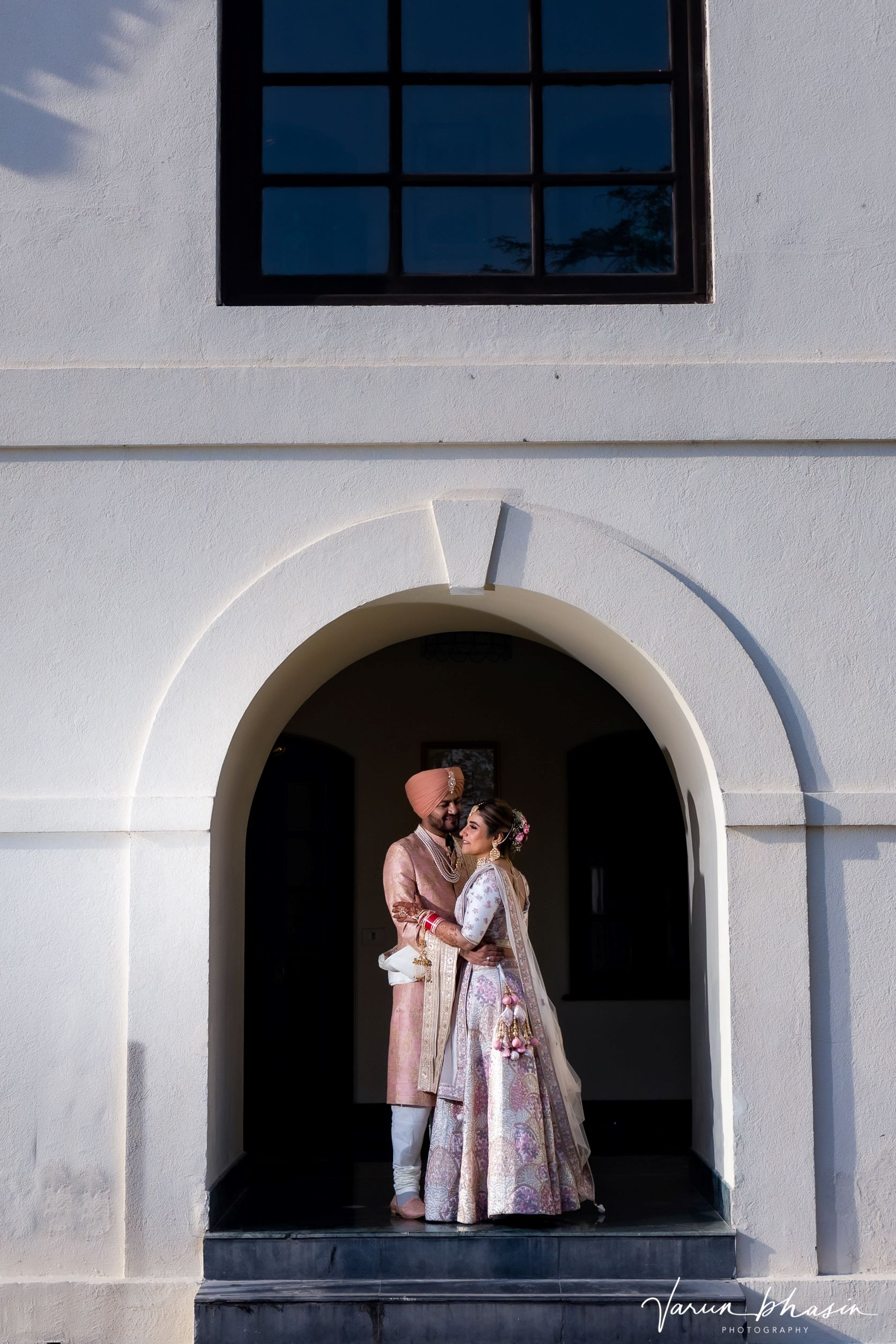 happy punjabi couple in pink