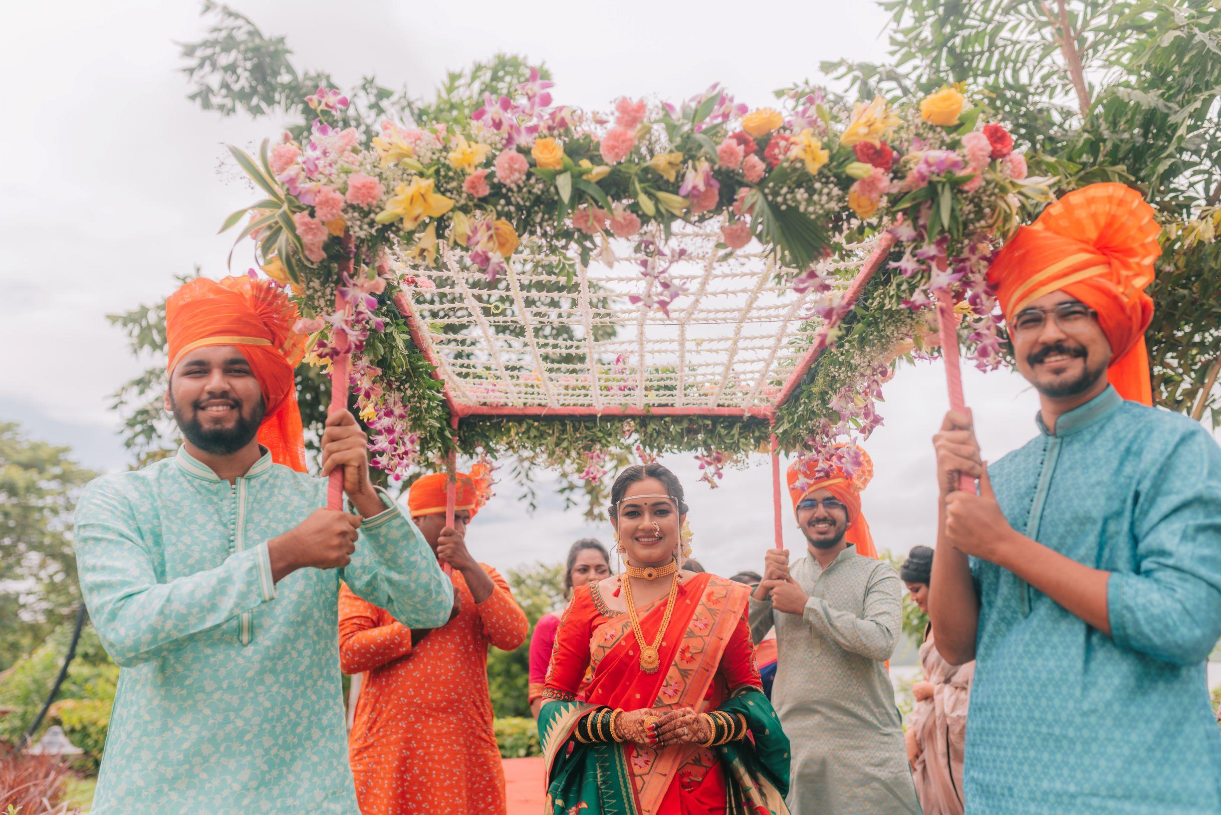 maharashtrian bride enters under a floral chhatri