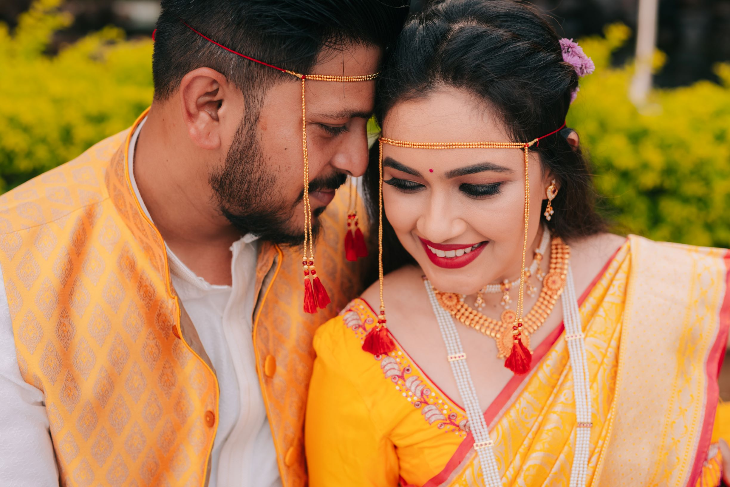 maharashtrian couple in coordinating yellow outfits