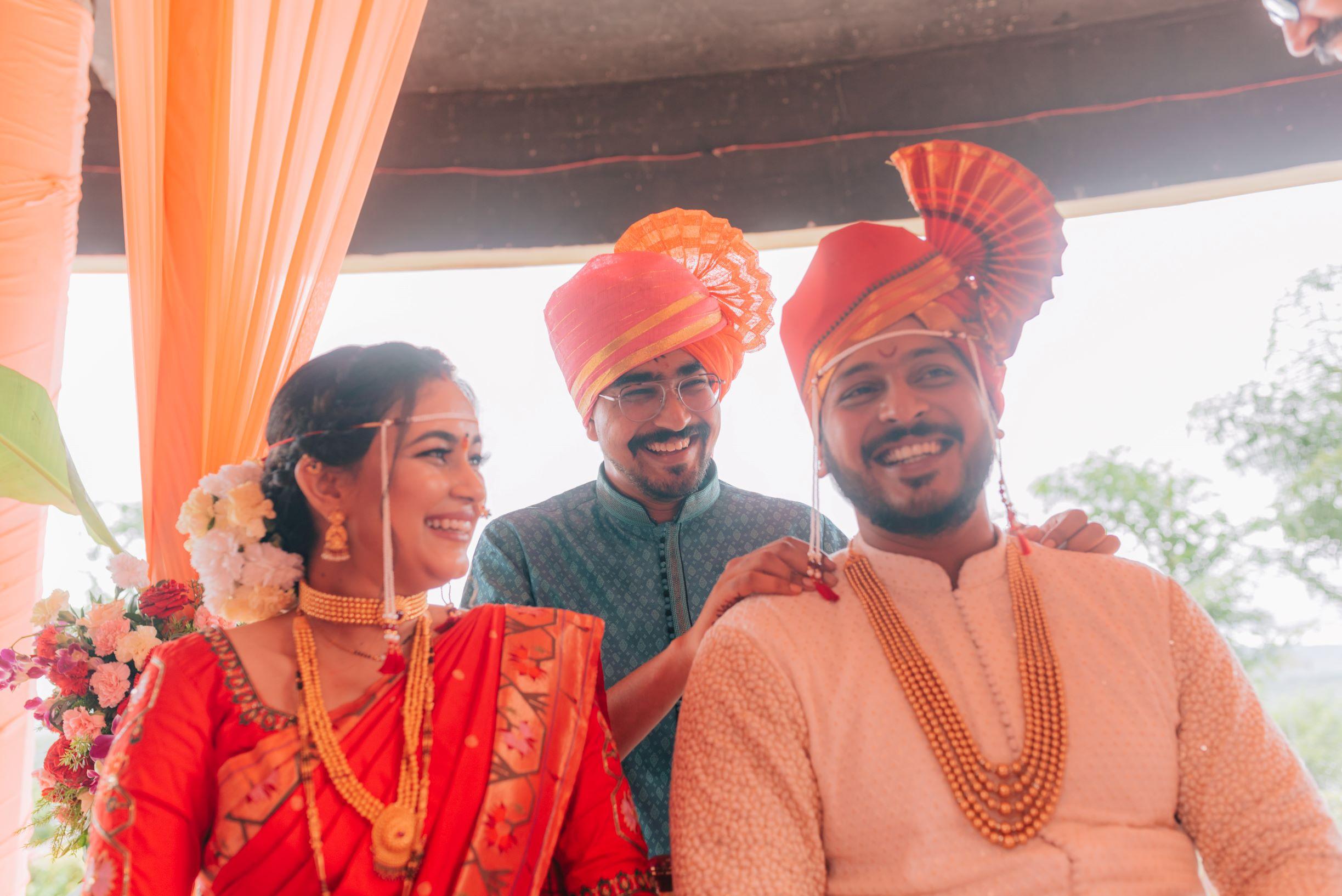 maharashtrian couple in orange traditonal outfits