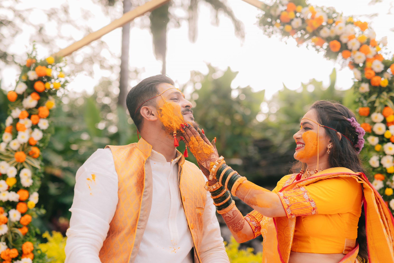 maharashtrian couple in yellow at their haldi