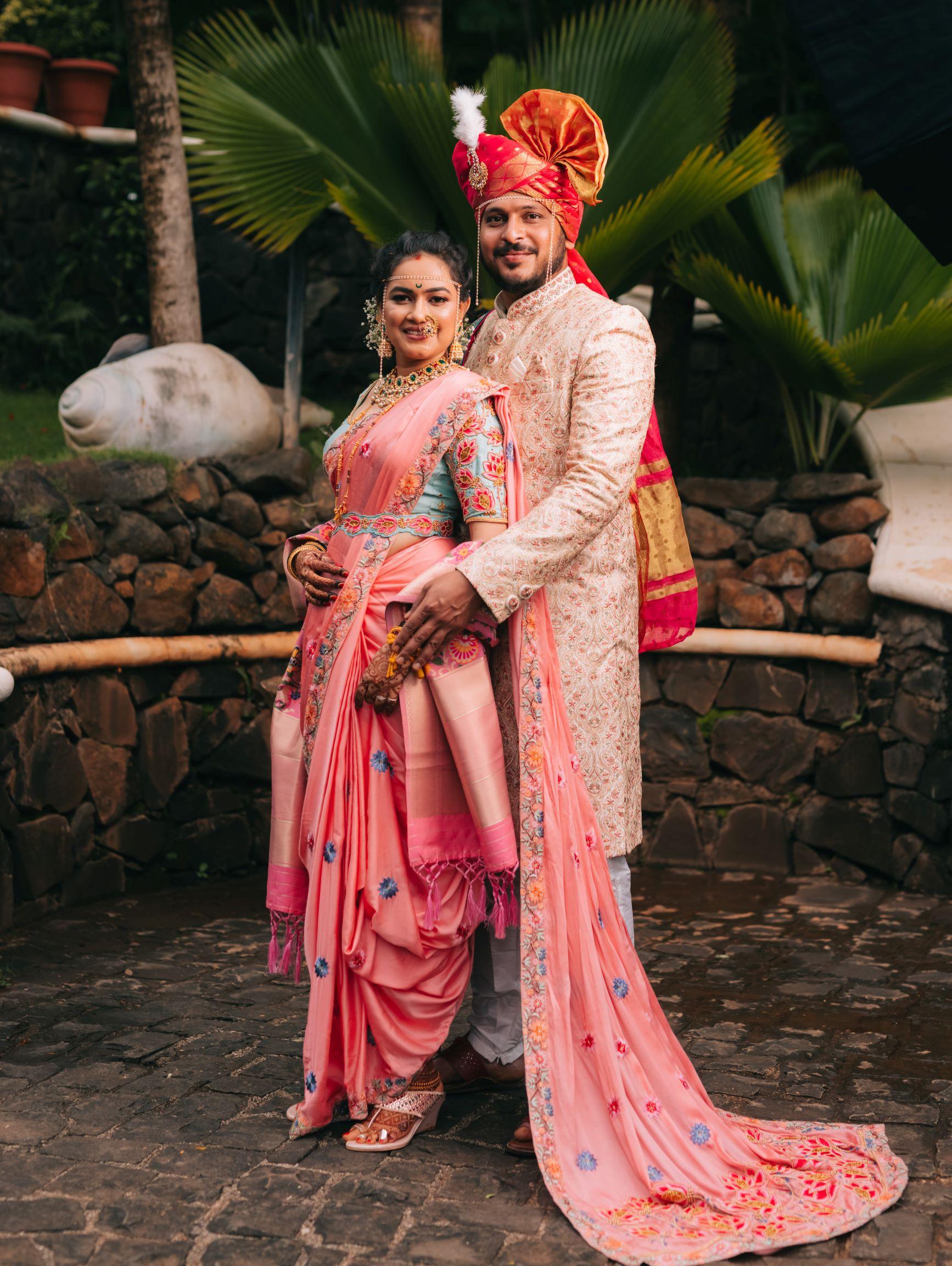 maharashtrian couple pose together at their wedding