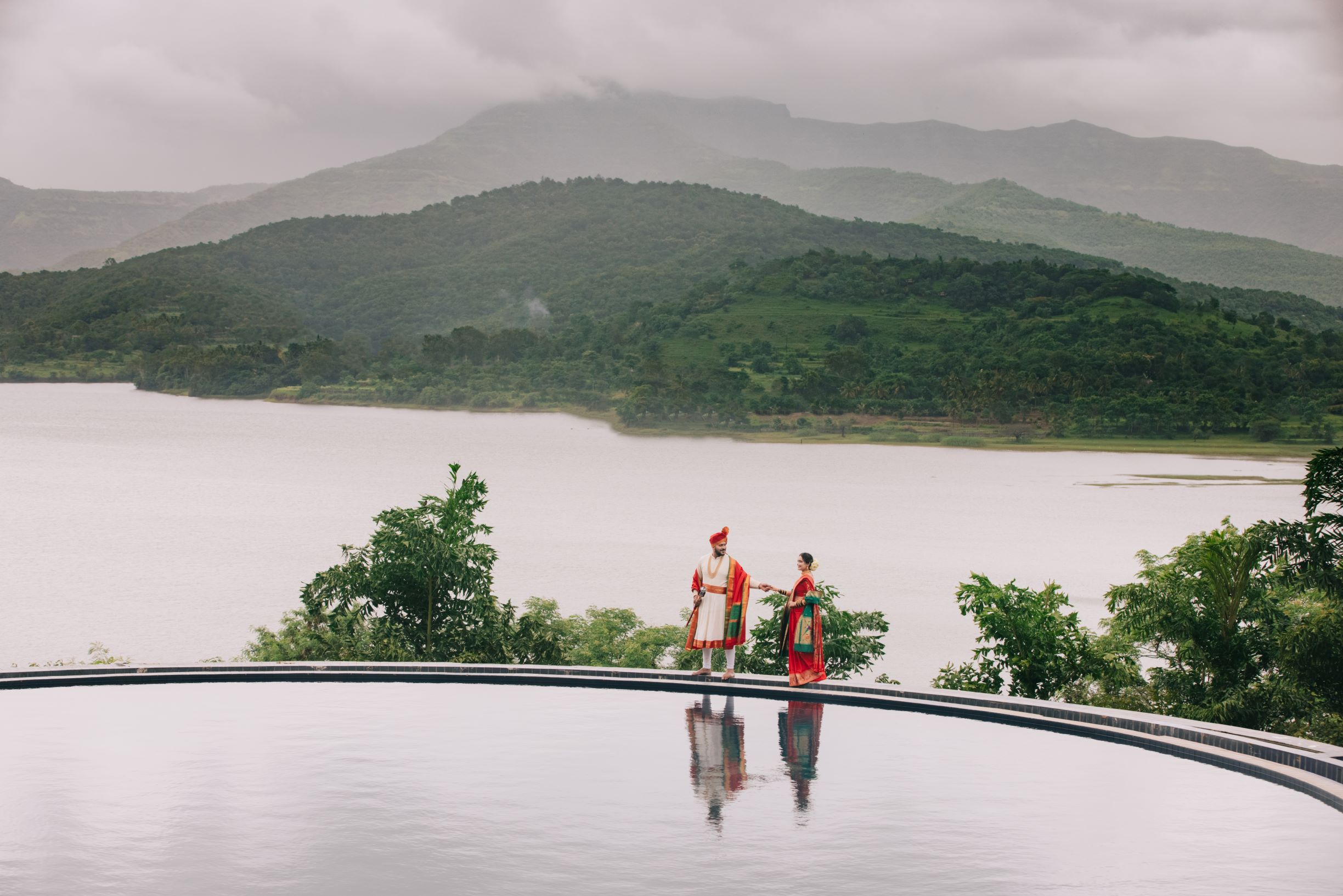 maharashtrian couple poses in front of a pool