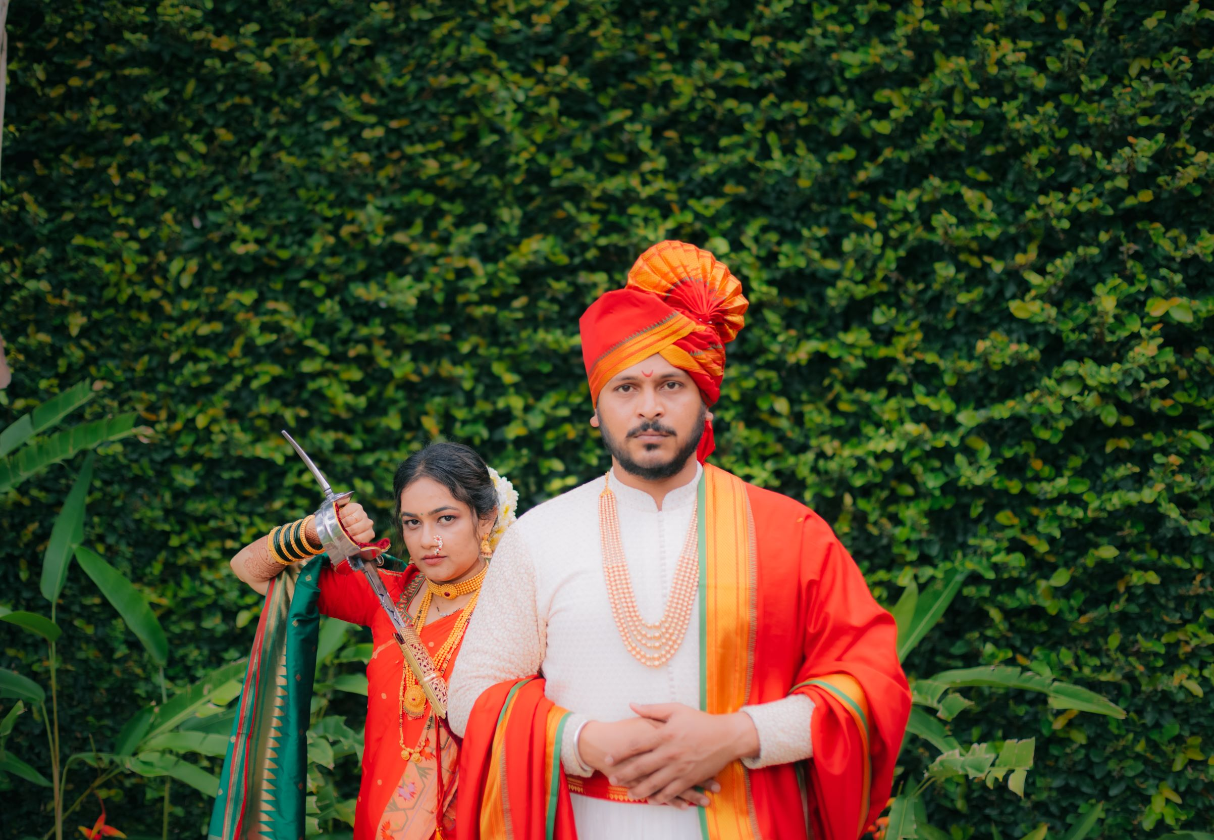 marathi couple pose with a sword