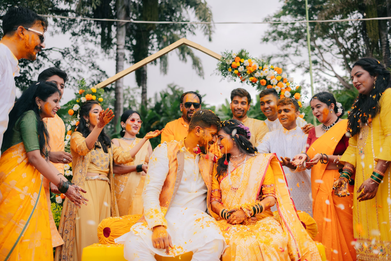 marathi couple poses with their family at their haldi