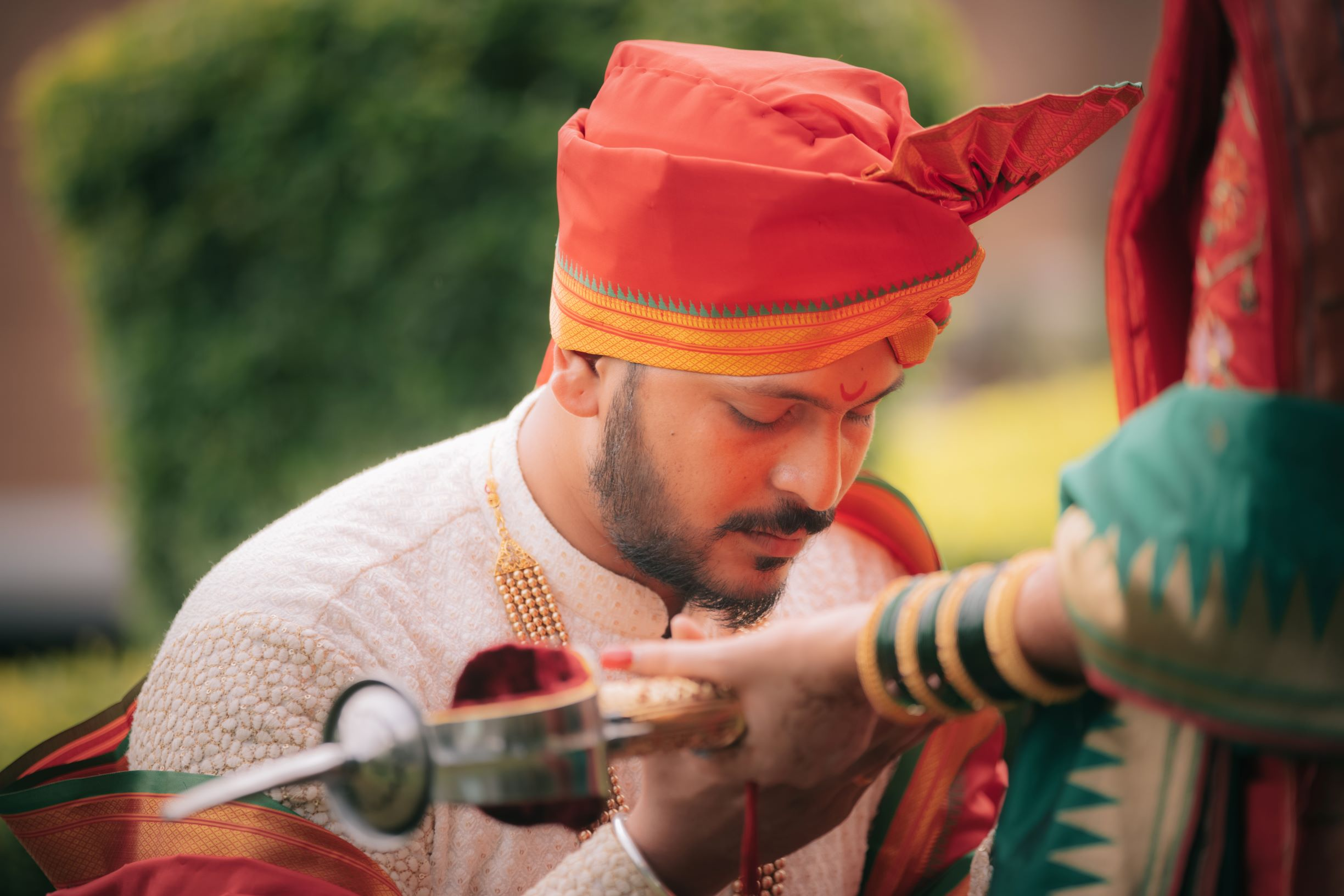 marathi groom poses with a sword