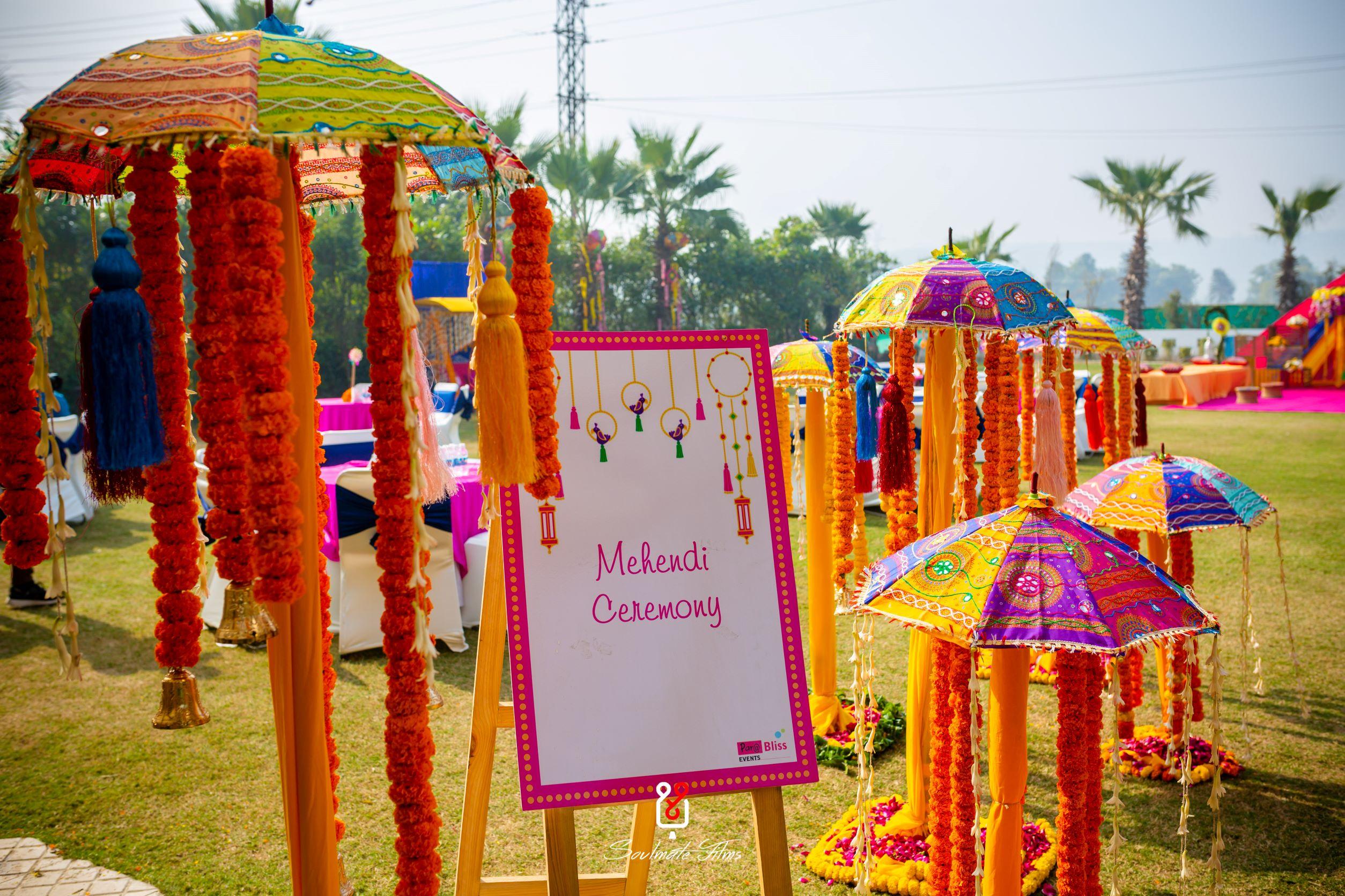 marigold and vibrant umbrella mehendi decor