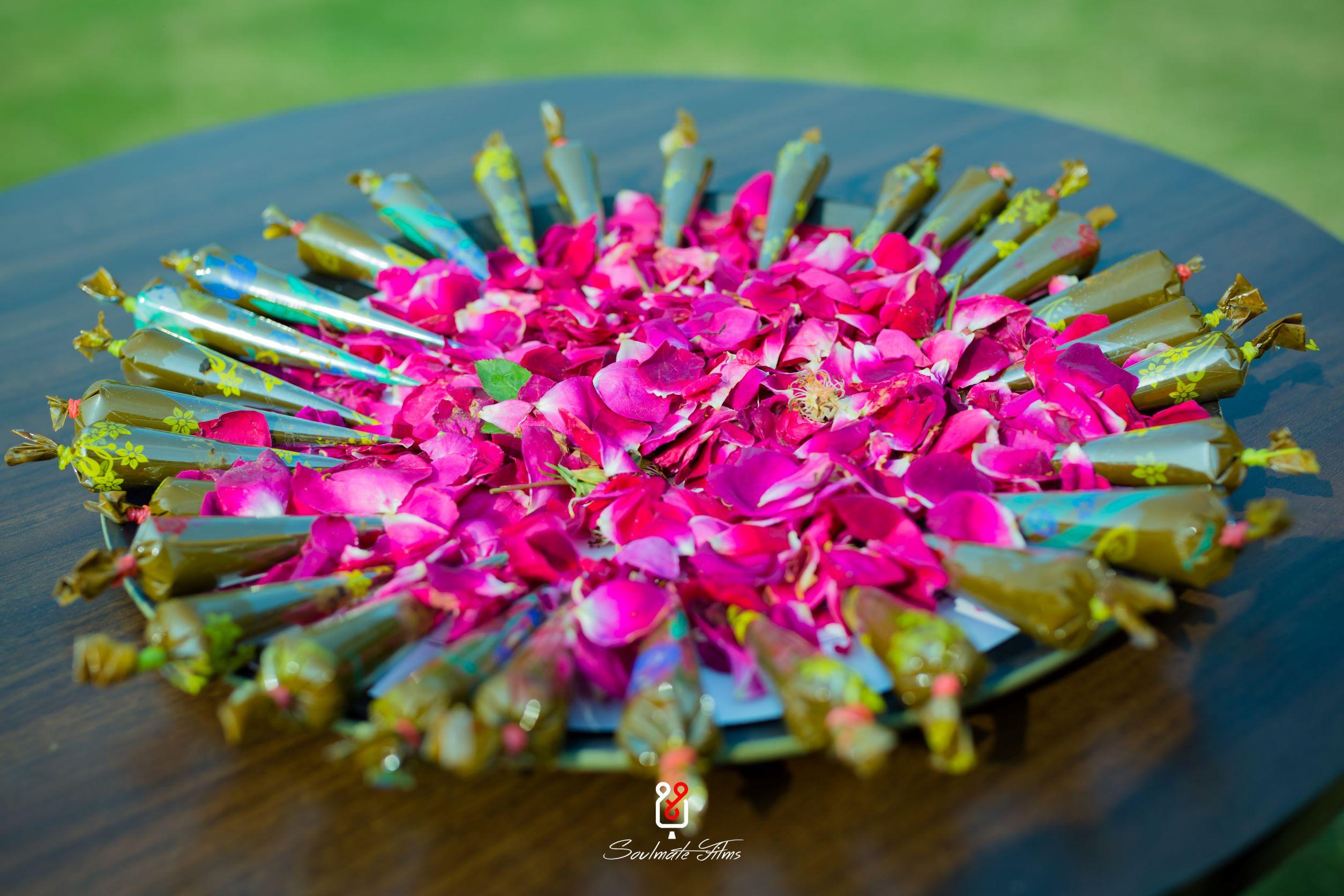 mehendi cones decorated with rose petals