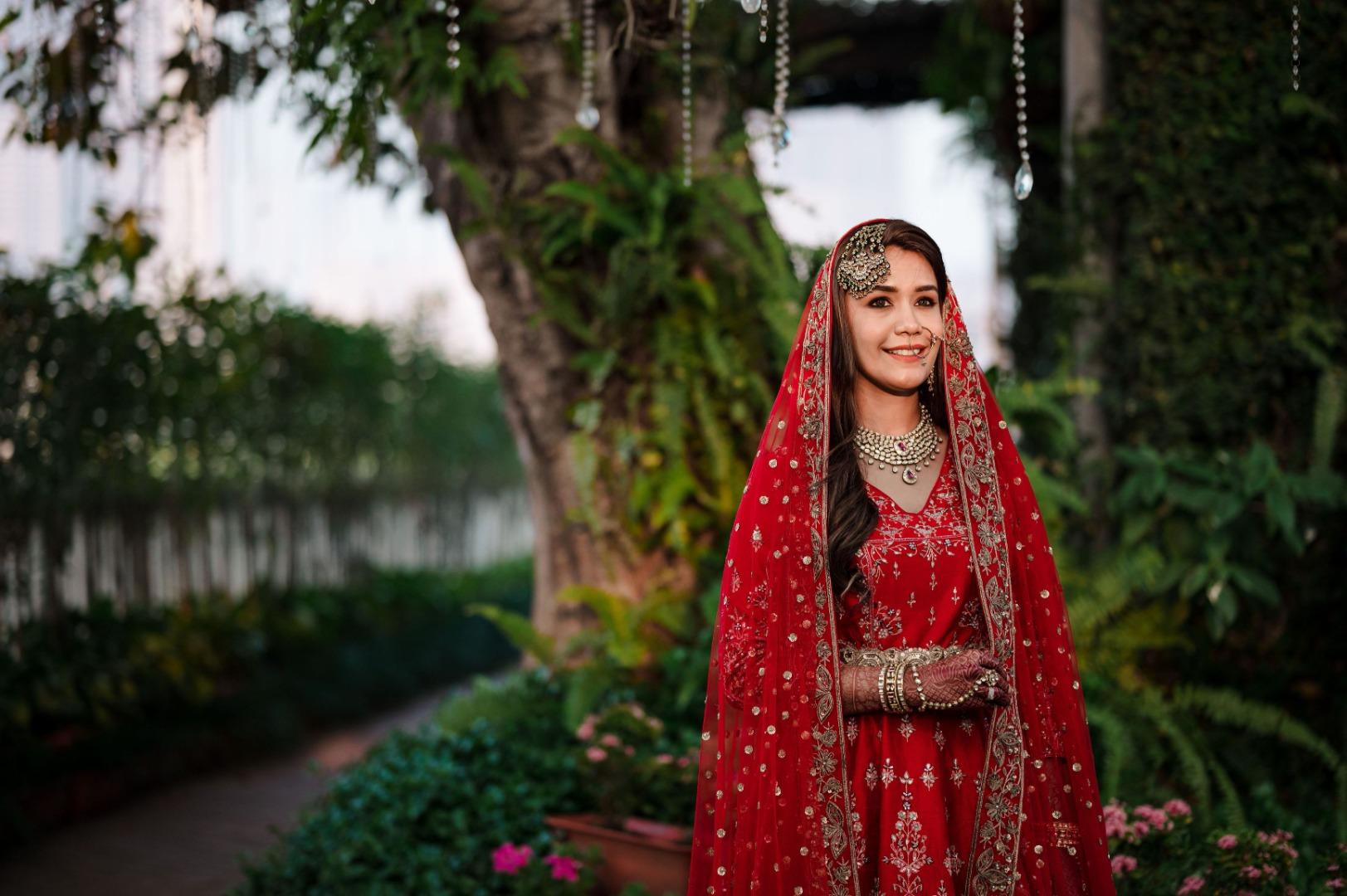 happy bride in red bridal suit