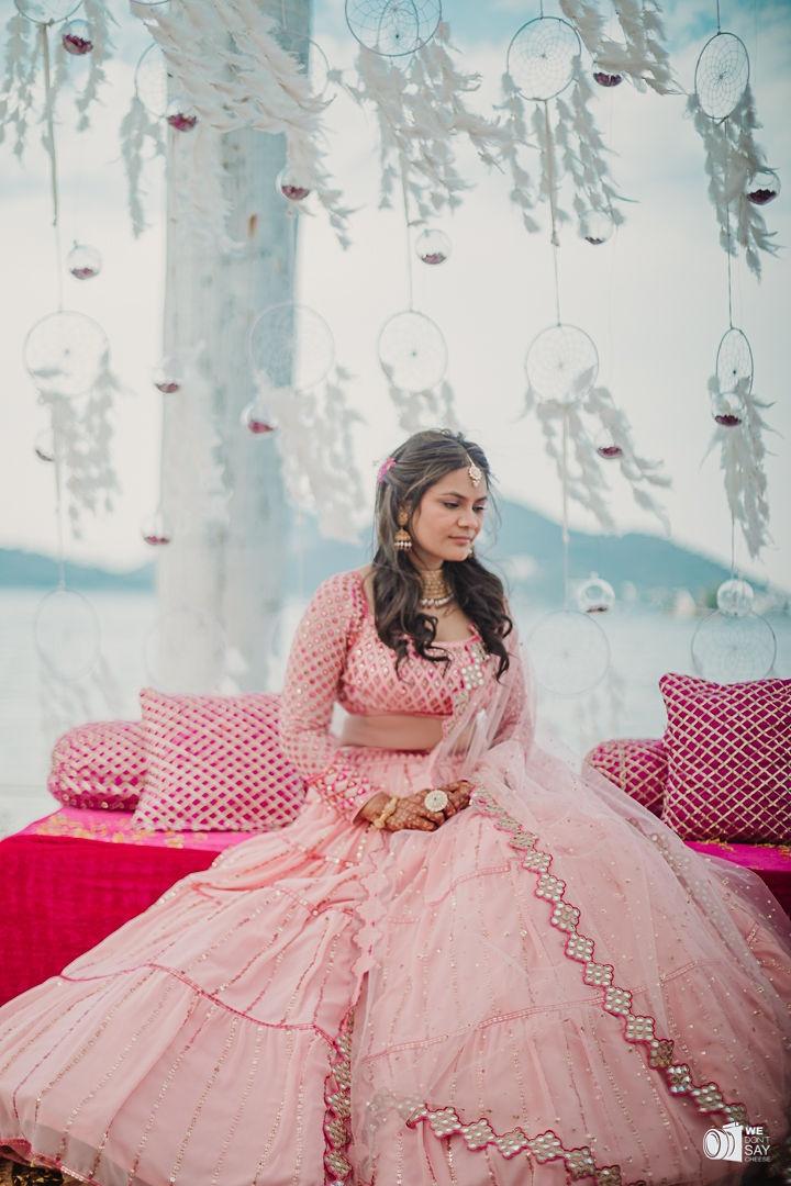 pretty bride in pink bridal lehenga