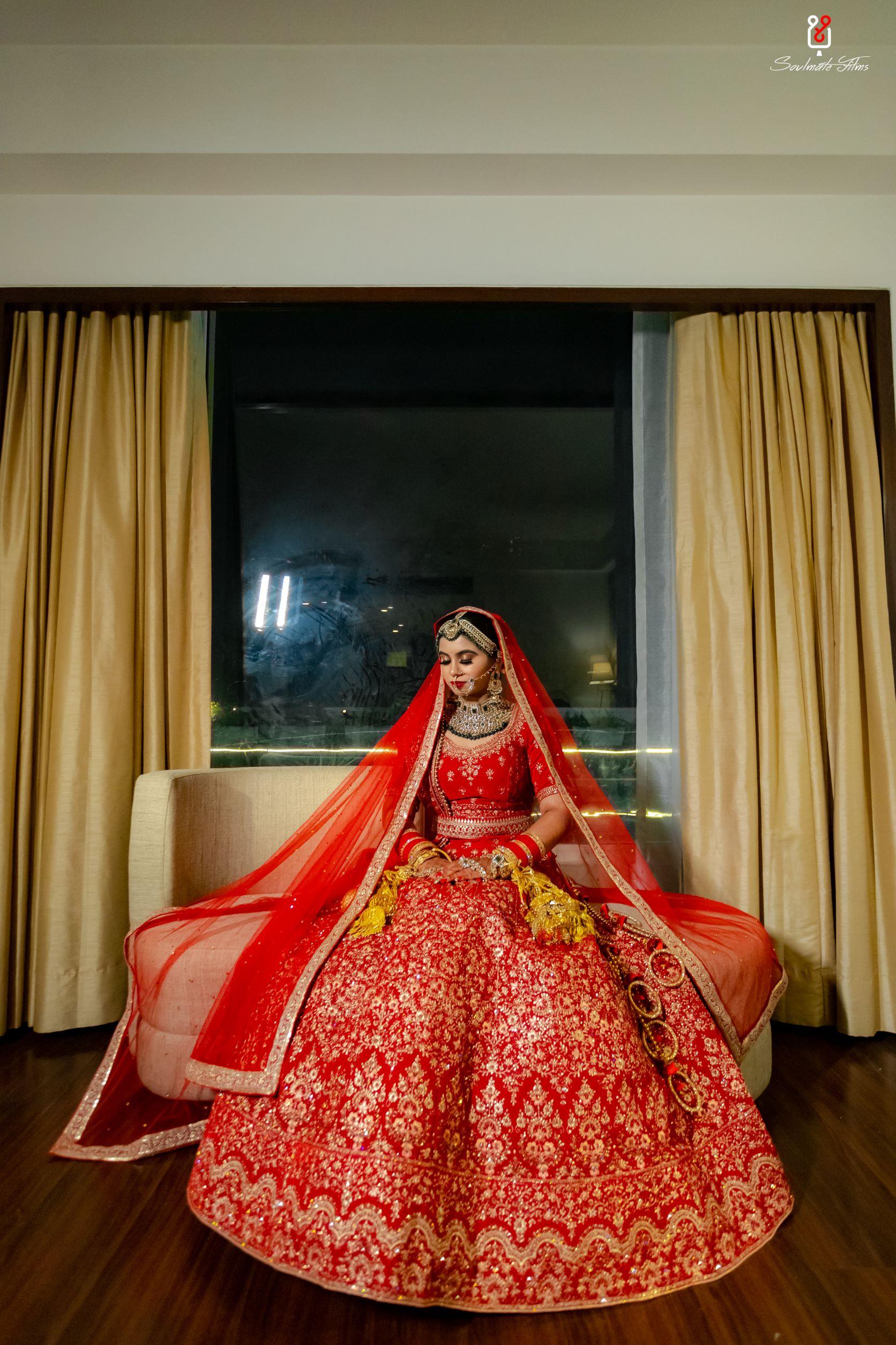 pretty bride in red bridal lehenga