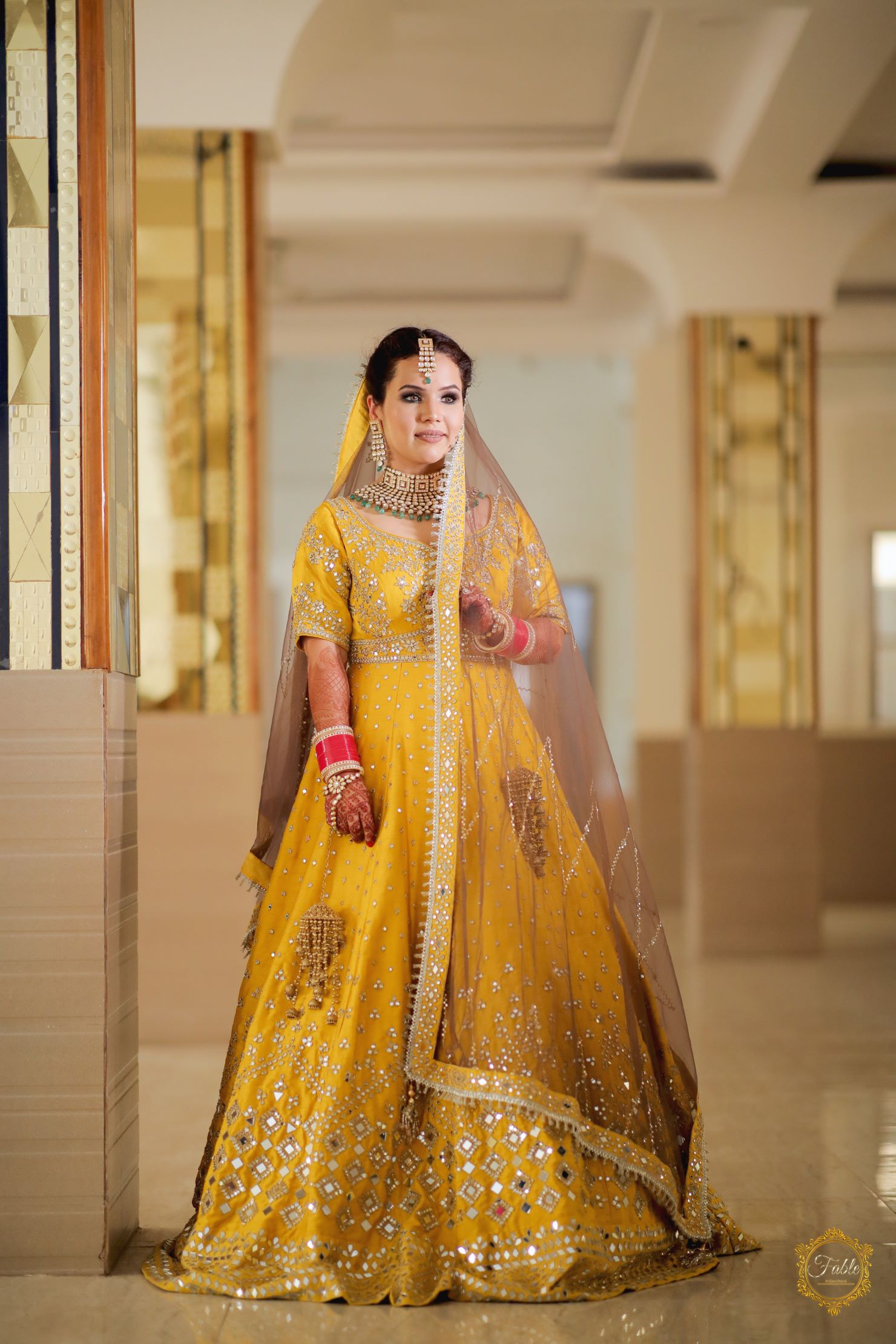 pretty bride in yellow bridal lehenga
