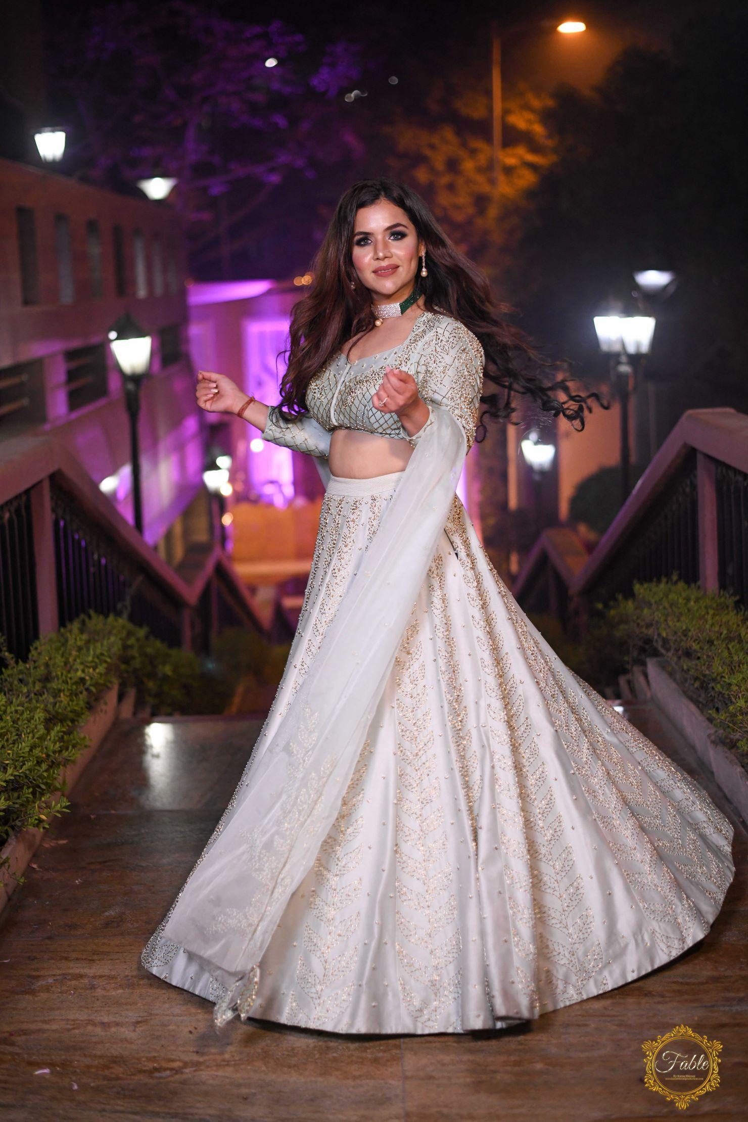pretty bride twirls in her pastel lehenga