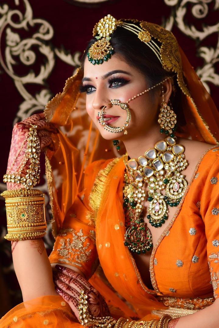 bride in orange outfit