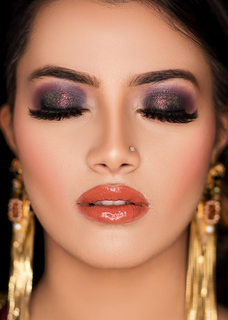 metallic eye makeup with nude lip