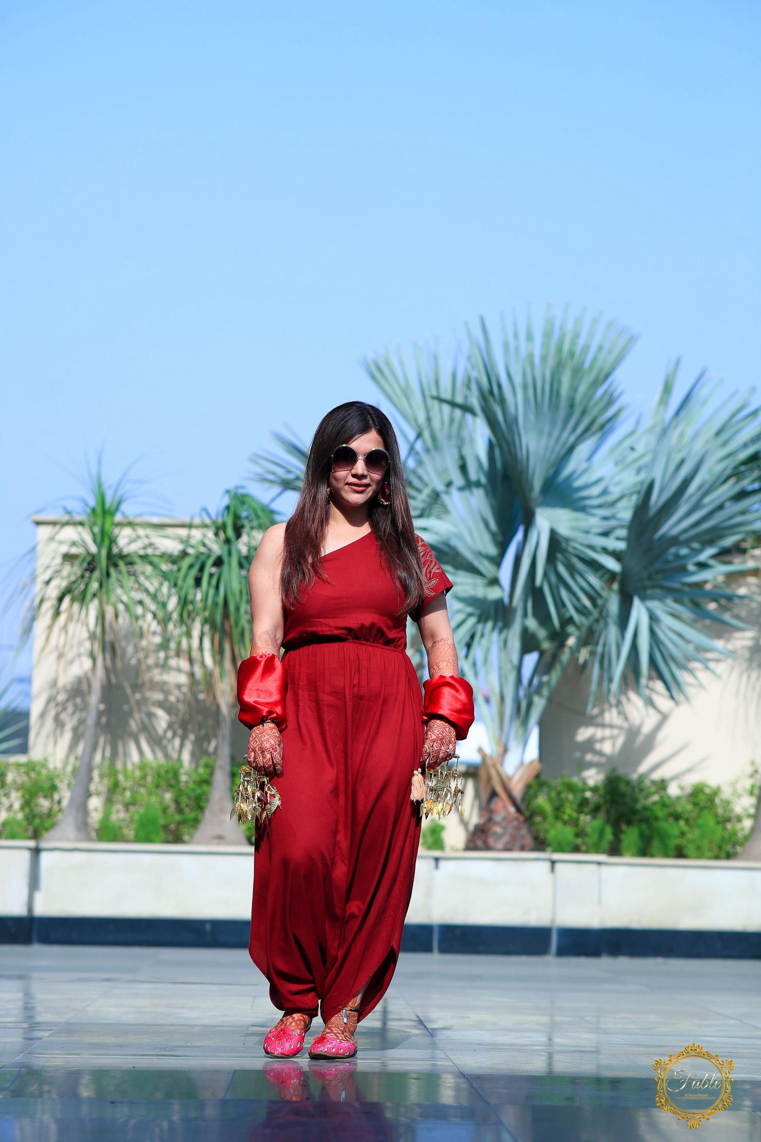 punjabi bride in red jumpsuit