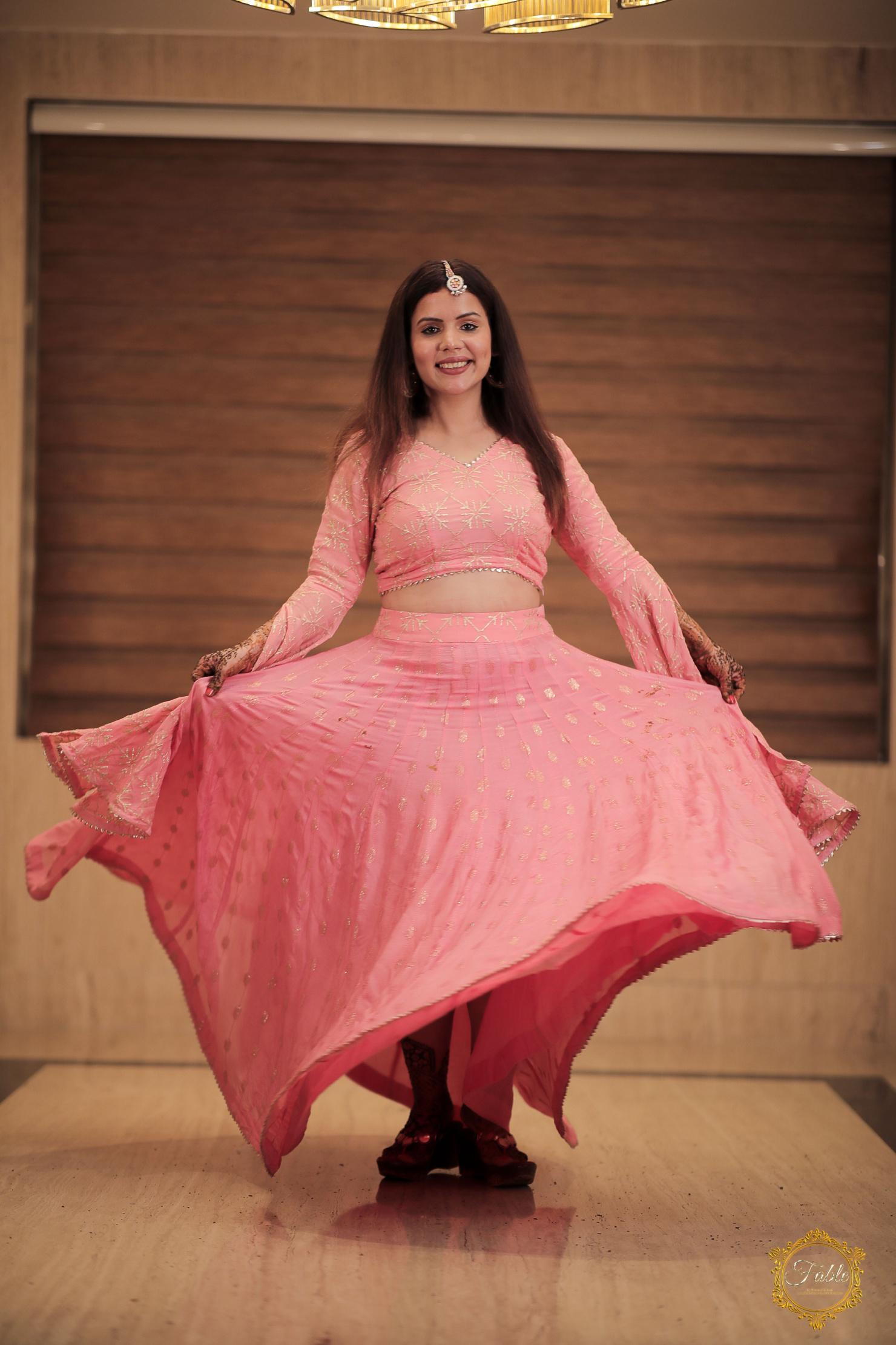 punjabi bride twirls in her pink lehenga