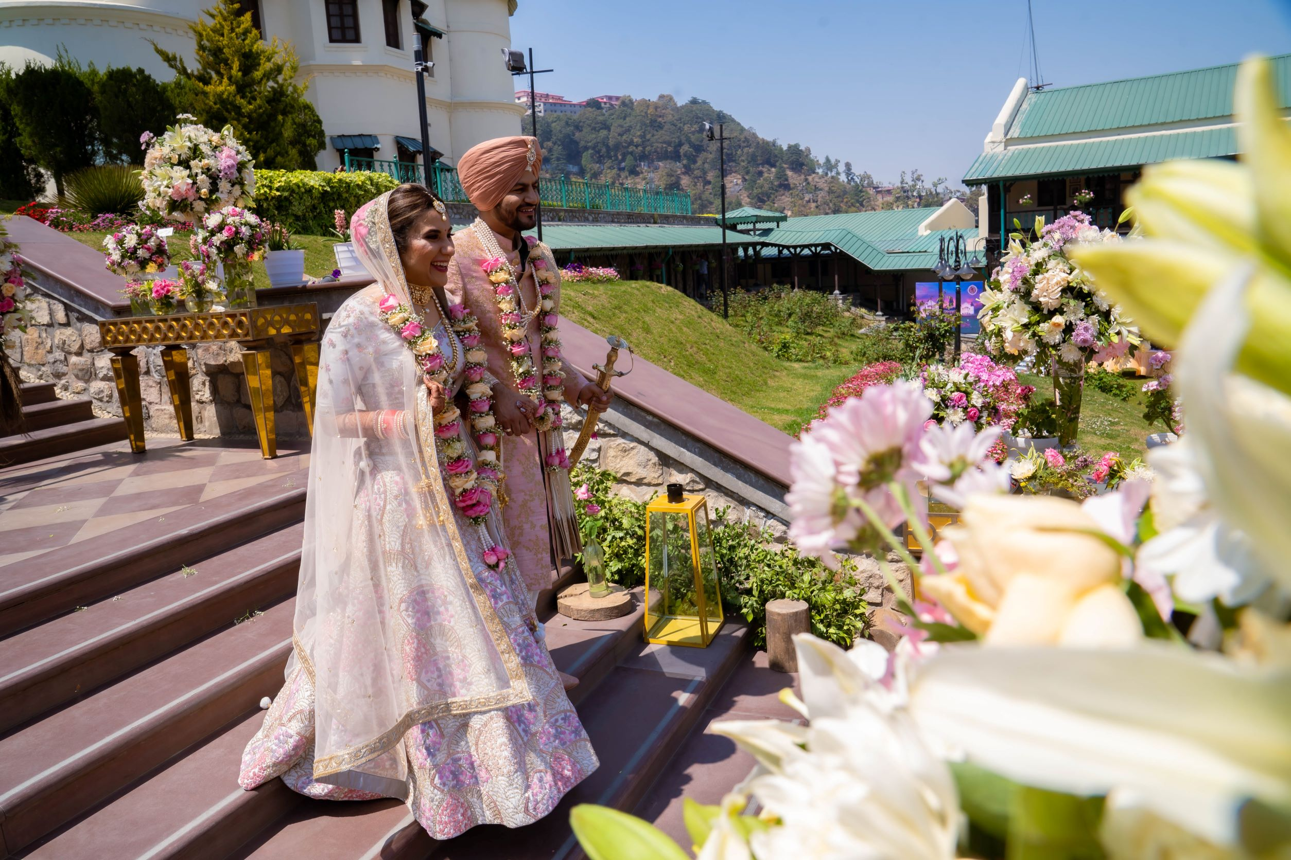 punjabi couple in coordinated wedding outfits