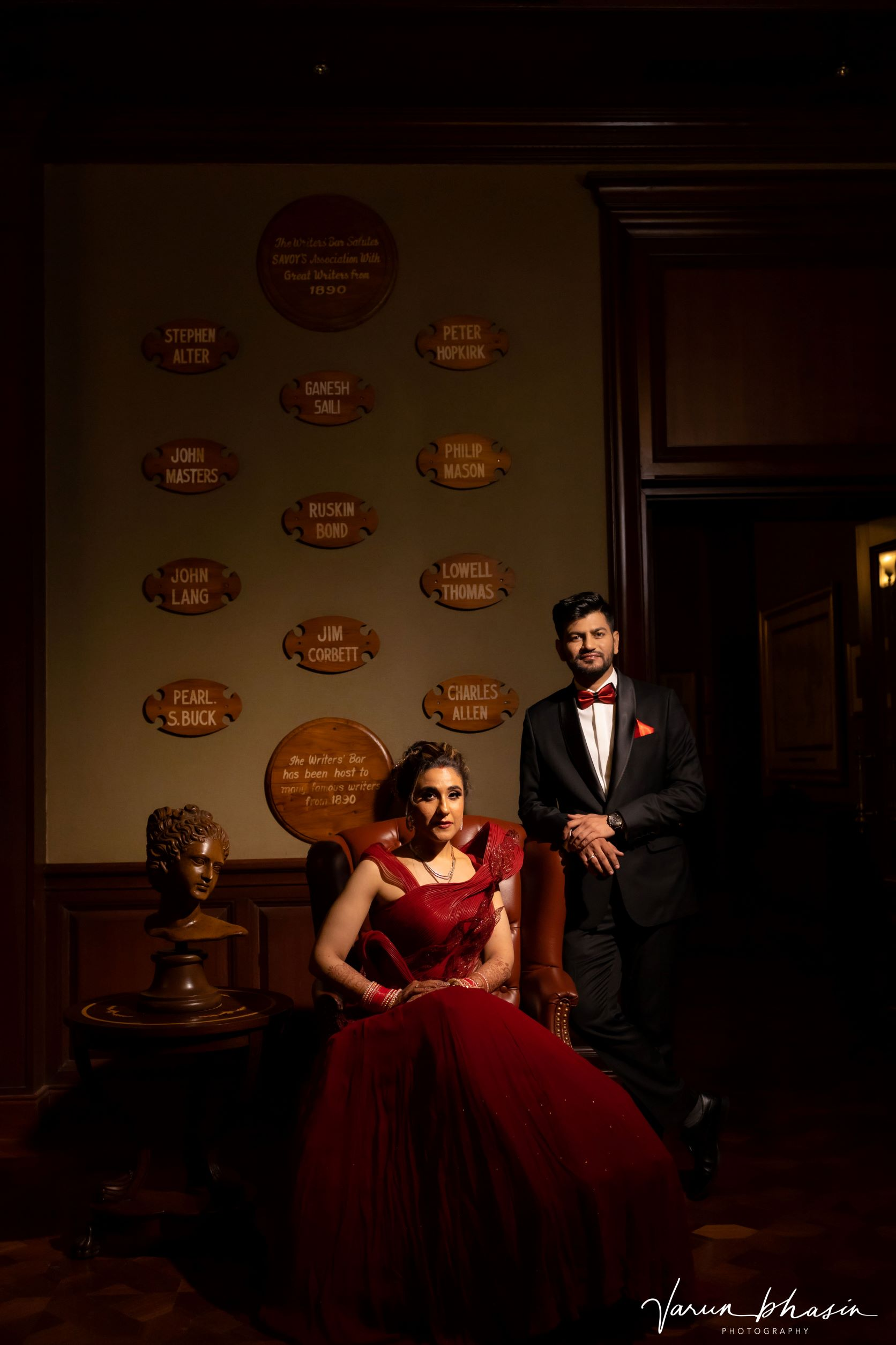 regal couple in contrasting outfits