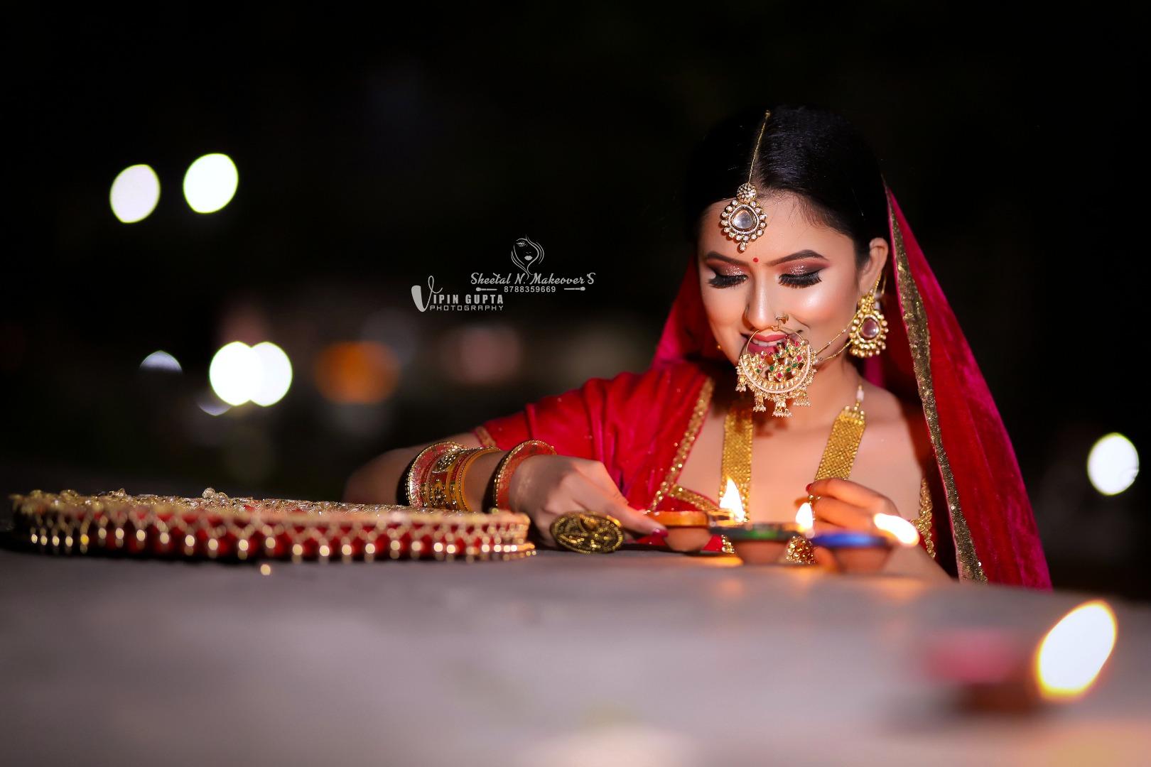bride poses with a diya