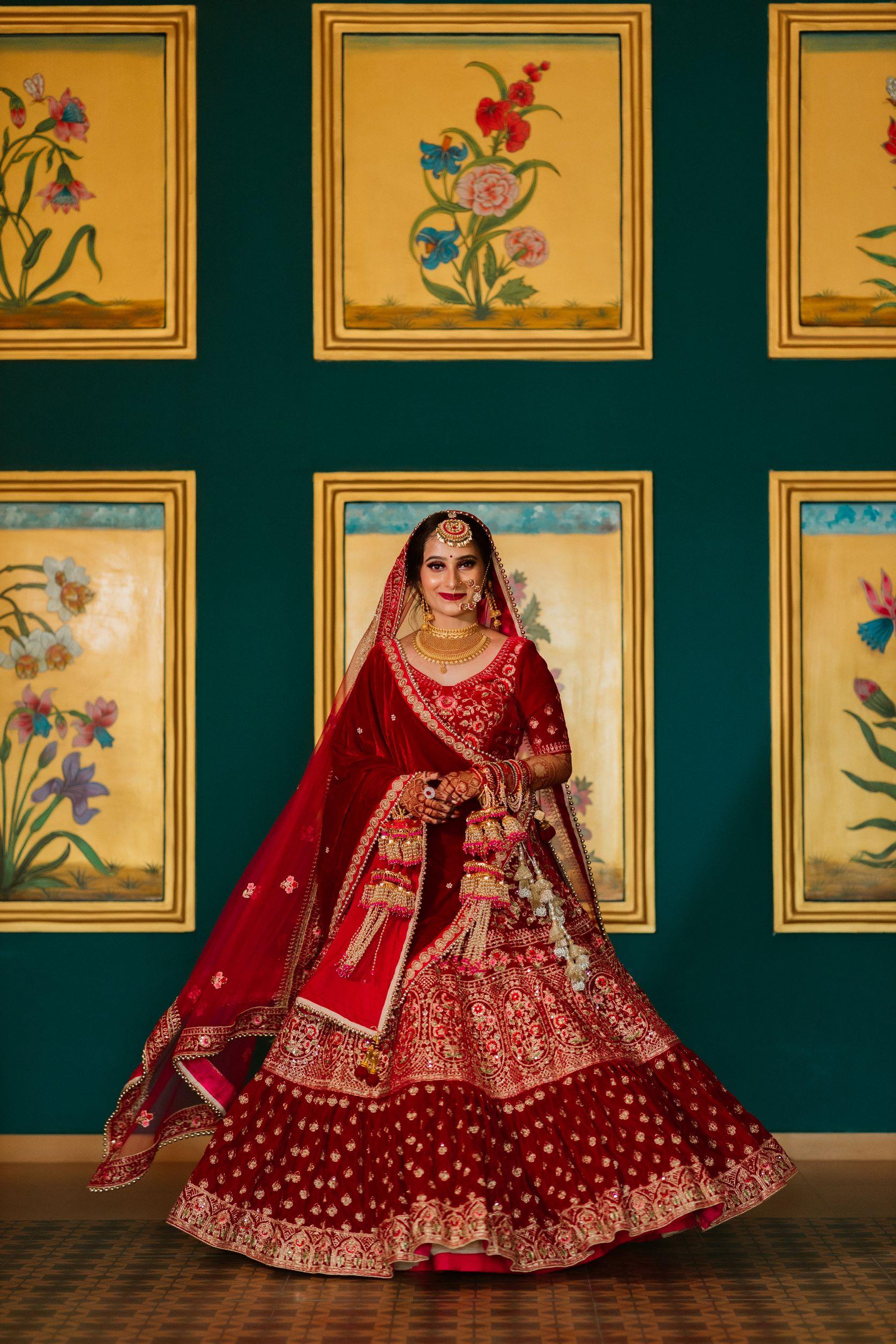 tradtional bride in red bridal lehenga